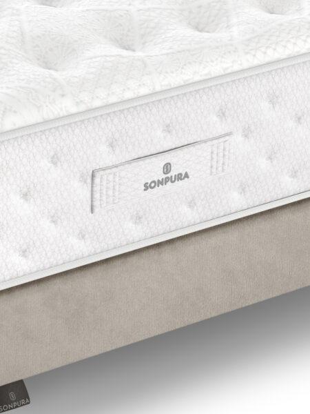 Detalle de colchón con muelles ensacados 16a-0003 blanco y beige vista de detalle