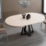 Mesa de comedor redonda extensible 14b-0016 color beige y negro vista ambiente abierta